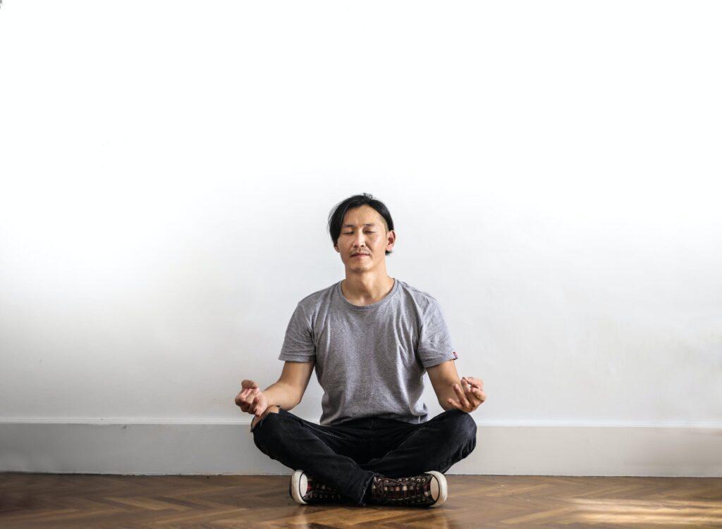Man sitting on floor meditating