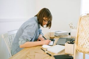 Female virtual assistant writing on paper to