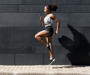 Female exercising to have a productive morning routine