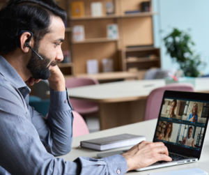 A man using online collaboration tools to connect with his team