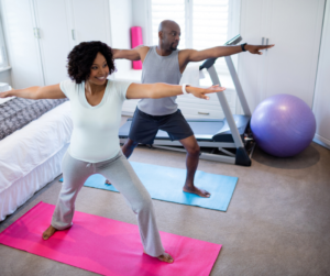 Man and woman exercising as a way of stress management