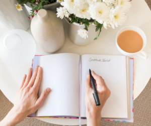 A woman writing in her journal to reduce stress