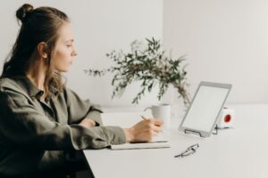 Woman sitting at laptop booking appointments