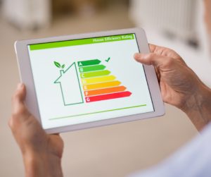 A person holding a tablet showing energy efficient results