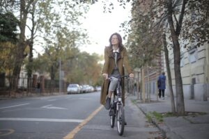 A woman cycling in the streets