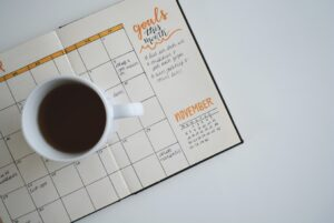 A cup of coffee and a notebook with a set of goals