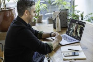A man and woman having a virtual meeting that could be an email which is a common time-wasting trap