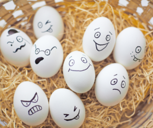 Eggs in a basket with different expressions