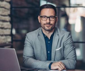 A male entrepreneur sitting at a desk