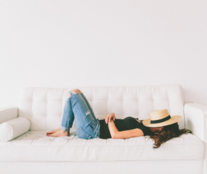 A woman lying on a couch taking a break