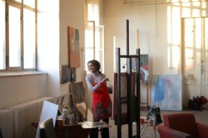 A woman painting in a studio